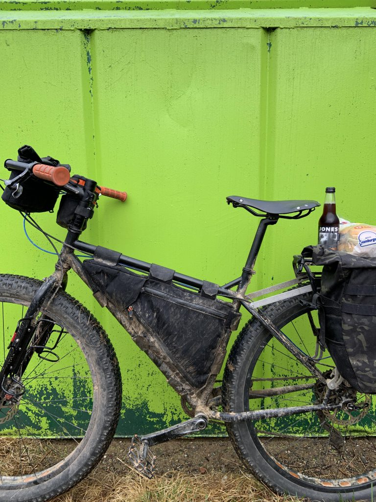 Surly pugsley against a dumpster.